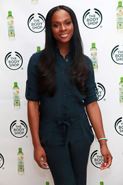 Tika Sumpter styled her long locks in a center part style with a slight curl at the ends.