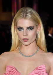 Lucy Boynton looked liked Barbie with her sleek blonde hair and strapless pink dress at the world premiere of 'Bohemian Rhapsody.'