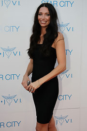 Erica dons a little black strapless dress with a mcqueen clutch.