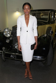 Naomie Harris went for sleek styling in a crispy white Burberry skirt suit when she attended the Bond in Motion press preview.