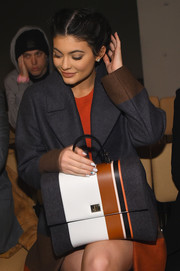 Kylie Jenner accessorized with a stylish striped tote at the Boss Fall 2016 show.