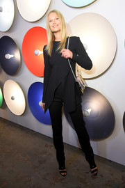 Toni Garrn wore a loose black crossover blouse by Boss when she attended the label's fashion show.