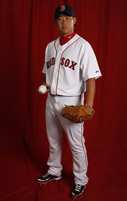 Daisuke Matsuzaka of the Boston Red Sox poses for a press photo while wearing his Nike baseball cleats.