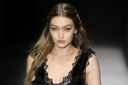 Gigi Hadid looked youthful wearing this half-up style while walking the Bottega Veneta show.