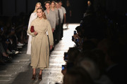 Lauren Hutton graced the Bottega Veneta runway wearing a classic beige trenchcoat.
