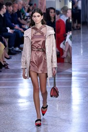 Kaia Gerber looked cute in a dusty-rose romper with crisscross shoulder straps at the Bottega Veneta runway show.