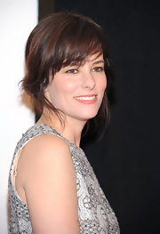 Parker Posey wore her hair in a casual bobby-pinned updo with soft, brow-grazing bangs at the premiere of 'We Bought a Zoo.'