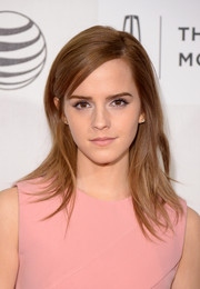 Emma Watson kept her beauty look subtle with pale pink lipstick.