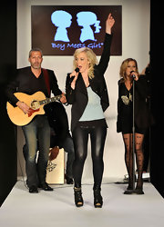 Natasha performed on stage at the Boy Meets Girl fashion show in tight leather leggings.