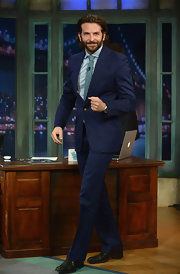Bradley Cooper looked debonair as ever in this dark navy two-piece suit, which he paired over a light blue button down and blue tie.