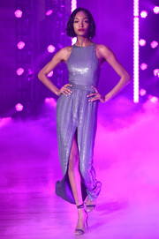 Black ankle-wrap sandals polished off Jourdan Dunn's runway look.