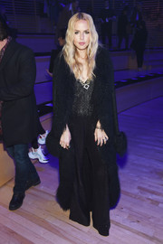 Rachel Zoe topped off her jumpsuit with an equally glam fur-trimmed coat.