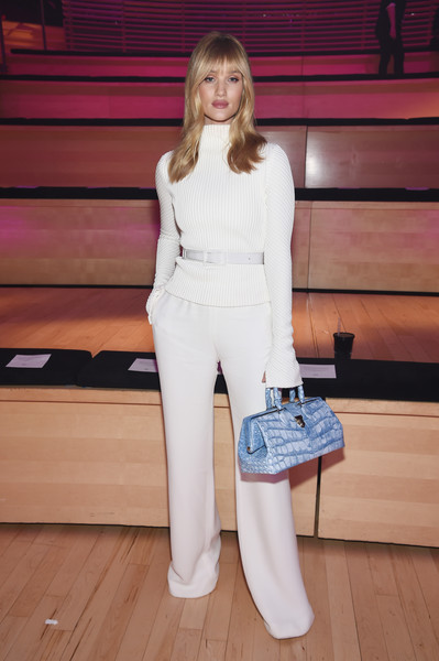 Rosie Huntington-Whiteley injected some color with a blue crocodile doctor's bag, also by Brandon Maxwell.