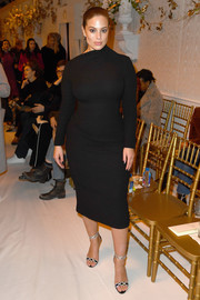 Ashley Graham put on a curvy display in a skintight LBD at the Brandon Maxwell fashion show.