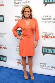Cat Cora brought Springtime cheer in a bright orange day dress at Bravo's 'Around the World in 80 Plates' finale celebration.