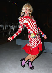Betsey is wearing a red striped dress with her loved brown leather New York belt.