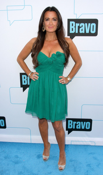 Kyle Richards added shine to her kelly green frock with gold platform pumps.