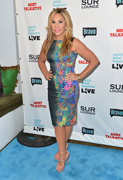 Adrienne Maloof paired sky-high nude platform sandals with her chic dress.