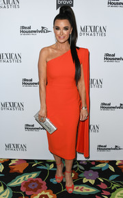 Kyle Richards matched her dress with red ankle-strap peep-toes.