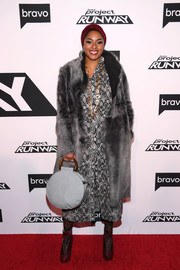 Alicia Quarles attended the 'Project Runway' New York premiere wearing a gray fur coat over a print dress.