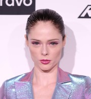Coco Rocha paired winged liner with pink shadow for her dazzling eye makeup.