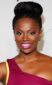 Kandi Burruss wore her shiny braided locks styled in a voluminous classic bun while attending Bravo Upfront 2012.
