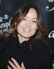 Olivia Wilde's brunette tresses looked long and soft when styled into simple waves.