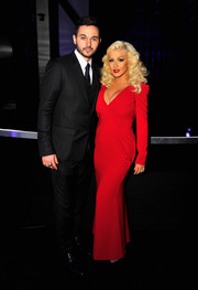 Christina Aguilera debuted her fabulous post-baby figure in a plunging red Rubin Singer gown during the Breakthrough Prize Awards.