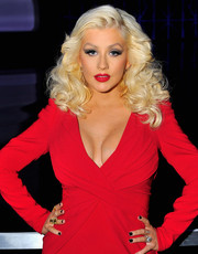 Christina Aguilera matched her dress with a fiery red lip.