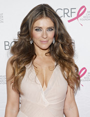 Elizabeth Hurley wore her tresses in face-framing waves during the Pink Carpet Party.