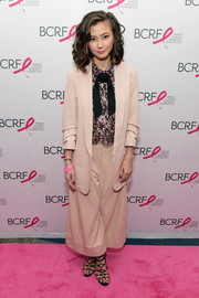 Kimiko Glenn teamed a beige wide-leg pantsuit with a print blouse for the Breast Cancer Research Foundation New York Symposium.