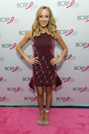 Nastia Liukin donned a beaded burgundy mini dress for the Breast Cancer Research Foundation New York Symposium.