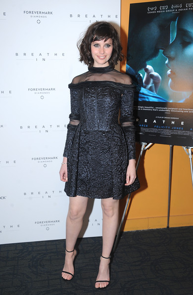 Felicity Jones completed her outfit with on-trend black Stuart Weitzman sandals.