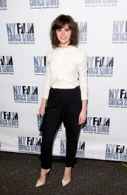 Felicity Jones teamed her blouse with a pair of tapered black slacks, also by Balenciaga, for a chic monochrome look.