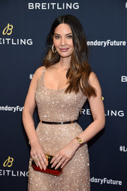 Olivia Munn polished off her look with a faceted gold clutch by Tyler Ellis.