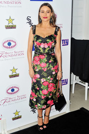 Sofia Vergara was sweet and pretty in a floral frock by Dolce & Gabbana at the Brent Shapiro Foundation Summer Spectacular.