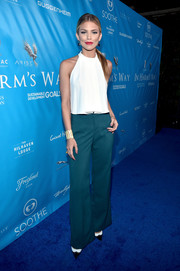 AnnaLynne McCord chose a pair of emerald-green wide-leg pants to complete her outfit.