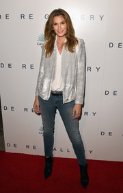 Cindy Crawford spruced up her look with a stylish silver blazer.