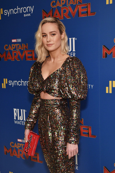 Brie Larson Printed Clutch [fiji water with the cinema society host a special screening of ``captain marvel,captain marvel,clothing,premiere,carpet,red carpet,dress,event,long hair,flooring,electric blue,brown hair,brie larson,new york city,cinema society,screening]