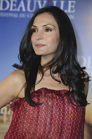 At the 'Bringing Up Bobby' photocall in Deauville, Famke Janssen's long, effortless waves and minimal makeup looked fresh and pretty. To recreate her look, use a large-barreled curling iron to make a subtle bend at the ends of tresses. To finish, lightly tousle with fingers.