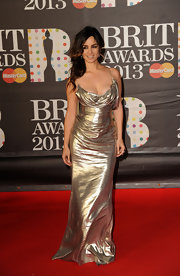 Berenice Marlohe brought her famous curves to the Brits in this draped silver bustier gown.
