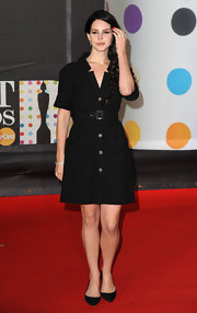 Lana's black belted shirtdress looked more appropriate for the office than red carpet, but she always looks lovely.