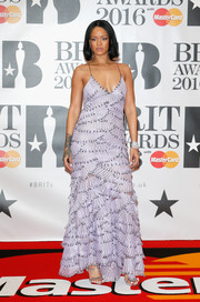 Rihanna was sweet and sexy at once in this plunging, tiered lavender gown by Armani Prive at the Brit Awards.