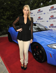 A pair of nude skinny pants topped off Claire Holt's chic red carpet look at BritWeek.