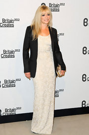 Jo Wood paired her beaded gown with a tailored black blazer for a smart monochrome look.