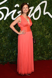 Katie Derham chose a sleeveless empire-waist gown in a bold coral hue for the British Fashion Awards.