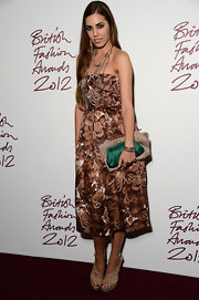 Amber Le Bon teamed up her brown floral dress with nude strappy heels at the British Fashion Awards 2012.
