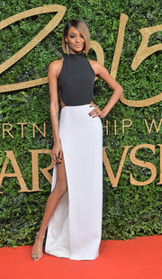 Jourdan Dunn worked the British Fashion Awards red carpet in a Mugler monochrome halter gown with a hip-high slit.
