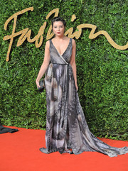 Daisy Lowe swept down the British Fashion Awards red carpet wearing a printed wrap gown in varying shades of gray.