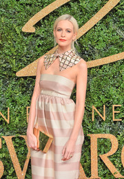 Poppy Delevingne arrived for the British Fashion Awards carrying an elegant mirrored box clutch.